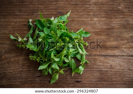 hoary basil or lemon basil put on old wooden background prepare for Thai food