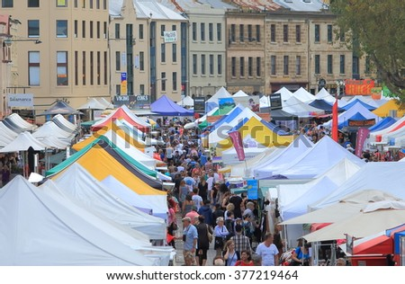 HOBART AUSTRALIA - MARCH 15, 2014: Unidentified people shop at Salamanca Market - Hobart is the state capital of Tasmania and Australia's second oldest capital city after Sydney.     - stock photo