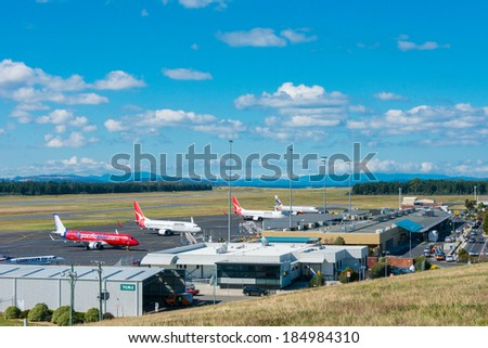 HOBART, TASMANIA/AUSTRALIA, MARCH 31ST: Image of a Jetstar Australia, Virgin Australia and Qantas passenger airliners at Hobart Airport on 31st March, 2014 in Hobart