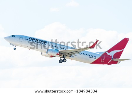 HOBART, TASMANIA/AUSTRALIA, MARCH 31ST: Image of a Qantas Australia passenger airliner taking off from Hobart Airport on 31st March, 2014 in Hobart - stock photo