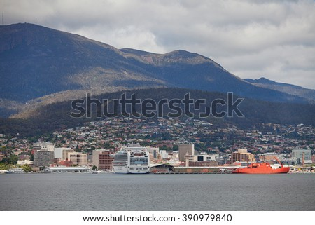 Hobart,Tasmania-December 16, 2012. View of the Hobart, the capital city of Tasmania, Australia, across the Derwent River, with curise ship and icebreaker in port - stock photo