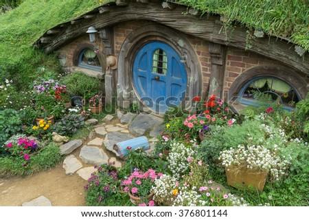 hobbit holes and hobbit garden in hobbiton movie set, new zealand. Taken during summer. - stock photo