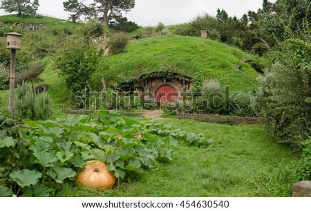 Hobbiton, New Zealand, 21st February 2016; small Hobbit house set for Hobbit movie shooting scene - stock photo