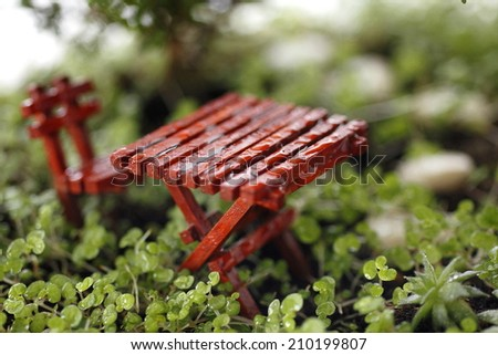hobby tree in the garden with table and chair