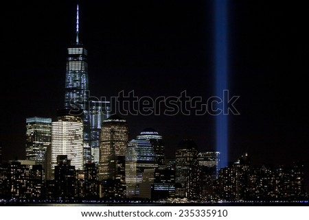 HOBOKEN, NJ - SEPT 11, 2014: New York City skyline with One World Trade Center and the annual Tribute in Light in Lower Manhattan on the anniversary of the terrorist attacks at Ground Zero in NYC. - stock photo