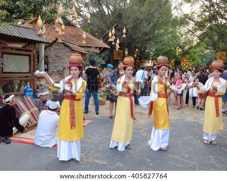 Hochiminh City, Vietnam - March 5, 2016: a folk dances of the Cham people in which the girls carry ceramic water jugs dancing at the culinary fair in the resort Van Thanh, Ho Chi Minh city