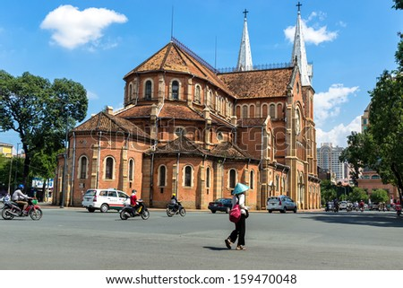 HOCHIMINH CITY, VIETNAM - OCTOBER 22: Notre Dame cathedral in Ho Chi Minh City, Vietnam on October 22, 2013. Built in French domination ( 1880) and designed by architecter J. Bourard. - stock photo