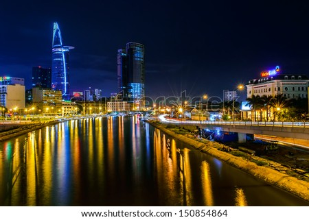 HOCHIMINH CITY, VIETNAM - SEPTEMBER 19:Night view of Bitexco Financial Tower at Hochiminh city on September 19, 2012. The Bitexco Financial Tower is the highest building in Vietnam.. - stock photo