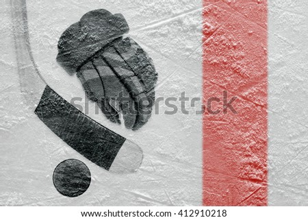 Hockey glove, stick and puck on a hockey rink. Concept - stock photo