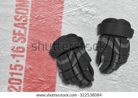 Hockey gloves on the ice arena. Concept - stock photo