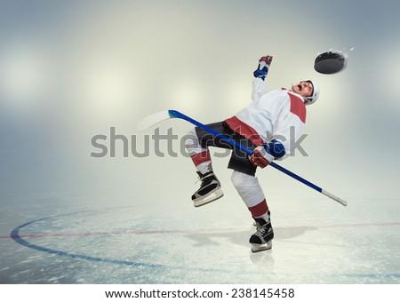 Hockey player fall dawn on ice - stock photo