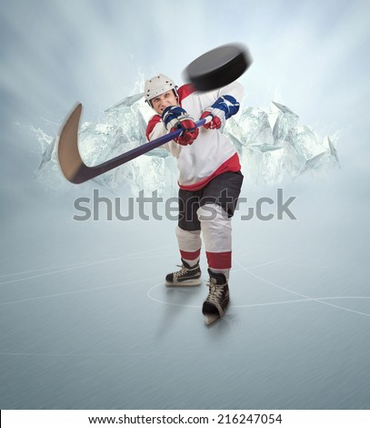 Hockey player gives powerful pass - stock photo