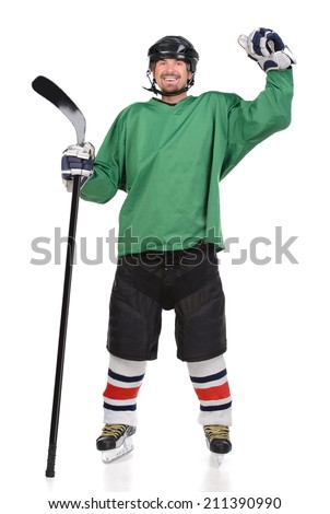 Hockey player is celebrating his victory with happy emotion. Isolated - stock photo