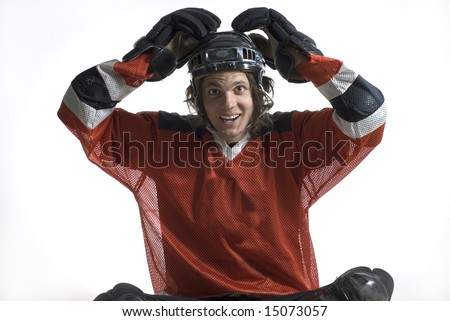 Hockey player jokes around with his hands on top of his head. Horizontally framed photograph - stock photo