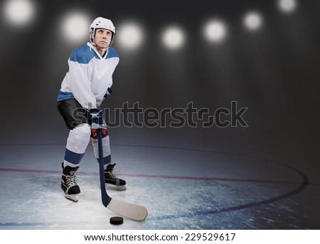 Hockey player on the ice in arena lights
