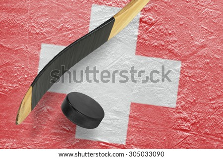 Hockey puck, stick and a fragment of an image of the Swiss flag