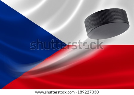 Hockey puck streaks across the flag of Czech Republic, where the country is one of the world's major ice hockey nations. - stock photo