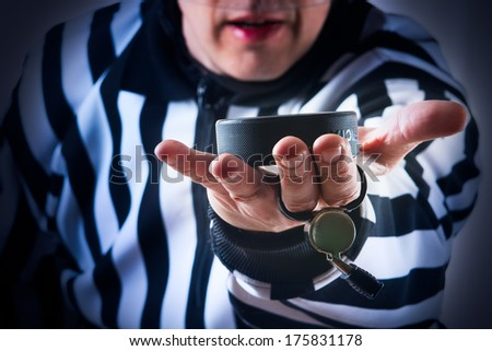 Hockey referee hold a puck in his palm. Close view - stock photo
