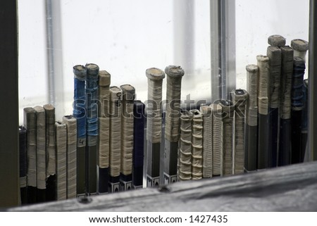 Hockey sticks rowed along the glass of the arena - stock photo