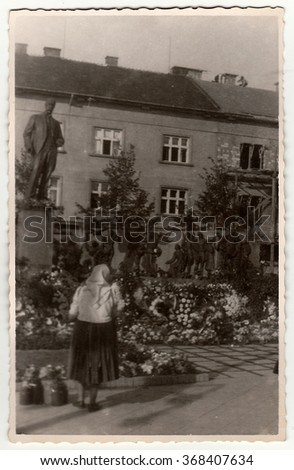HODONIN, THE CZECHOSLOVAK REPUBLIC, CIRCA 1940s: Vintage photo shows rural woman in front of sculpture (Tomas Garrigue Masaryk).
