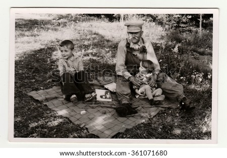HODONIN, THE CZECHOSLOVAK REPUBLIC, CIRCA 1941: The small children with their grandfather, circa 1941.