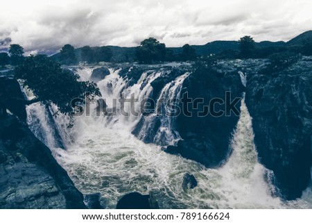 Hogenakkal is a waterfall in South India on the Kaveri river in the Dharmapuri district of the Indian state of Tamil Nadu