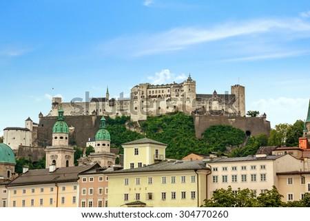 Hohensalzburg Fortress in Salzburg, Austria, view from the Salzach river - stock photo