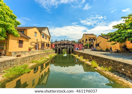 Hoi An, central Vietnam. July 20, 2016 : Ancient Vietnamese city of Hoi An. River in the city center. The background is a historic landmark Japanese Bridge. Hoi An, Vietnam