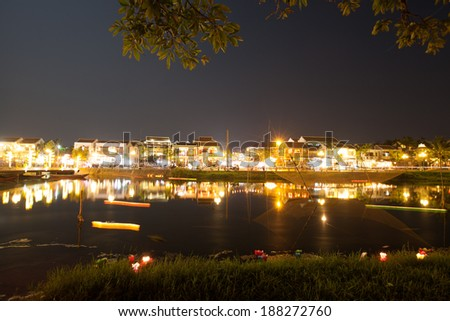 Hoi An town by night beside Hoai river, Quang Nam province, Central Viet nam - stock photo
