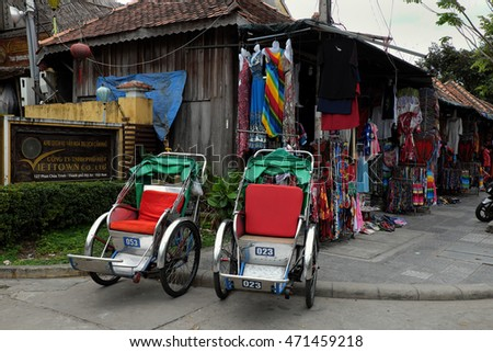 HOI AN, VIET NAM- FEB 17, 2016: Two pedicab park at souvenir shop to transport traveller at Hoi An old town, pedicabs are transfer vehicle that friendly with environment