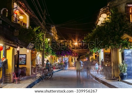 HOI AN, VIETNAM - CIRCA AUGUST 2015: People walking on the streets of old town Hoi An, Vietnam by night