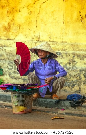 HOI AN, VIETNAM- JULY 16: local Vietnamese women street vendor in Hoi An on July 16, 2016 in Hoi An, Vietnam. Hoi An is the renown of World heritage cultural site.