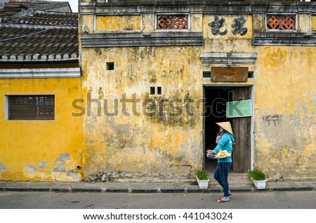Hoi An, Vietnam - May 21, 2016: The streets of Hoi An, a Unesco World Heritage site, a major touristic destination in Central Vietnam