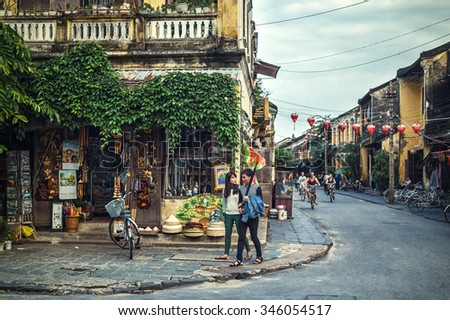HOI AN, VIETNAM - November 14: couple walking on the streets of Hoi An, Vietnam on Apirl 14, 2014 in Hoi An. Hoi An, a UNESCO World Heritage site, is a major touristic destination in Central Vietnam.