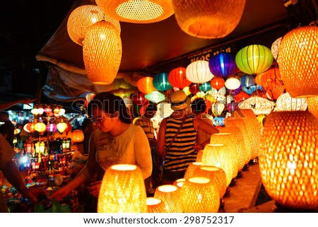 HoiAn, Vietnam - April 2015 - Customers choose silk lantern bazaar display hoi an vietnam