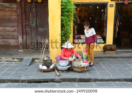 HOIAN, VIETNAM, JANUARY 23: Street vendor on January 23, 2015 in Hoian, Vietnam. Hoian is recognized as a World Heritage Site by UNESCO. - stock photo