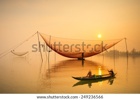HOIAN, VIETNAM - JANUARY 23 : Two women on boat go to market in sunrise in a village of Cua Dai, Hoi An, Vietnam on January 23, 2015. Hoian is recognized as a World Heritage Site by UNESCO.