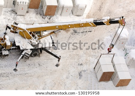 Hoisting works by mobile crane - stock photo