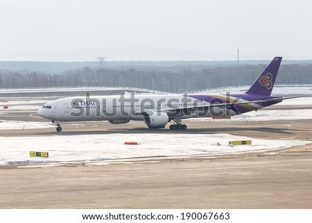 HOKKAIDO, Japan - MARCH 18: Thai Airways Boeing 777-300ER in New Chitose Airport on March 18, 2014 in Hokkaido, Japan. Thai Airways is the national flag carrier of Thailand.