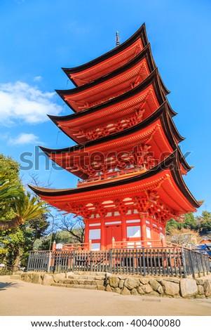 Hokoku shrine , Ancient Japanese wood pagoda with blue sky in Miyajima island, Hiroshima, Japan - stock photo