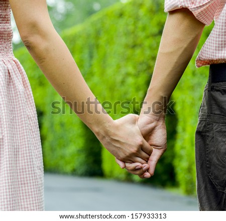 Hold hands of the couple