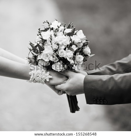 hold me, marry me, hands of a wedding  couple in black and white - stock photo