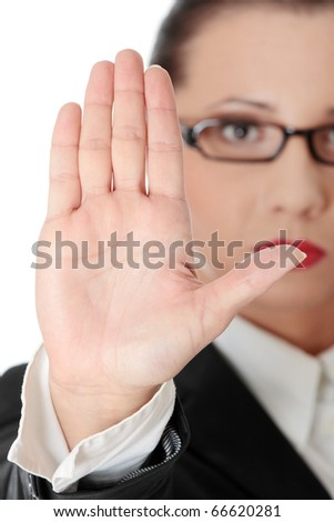 Hold on, Stop gesture showed by businesswoman hand - stock photo