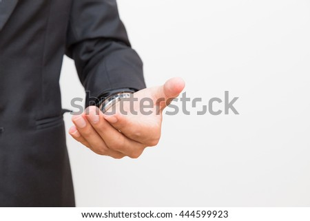 Hold some thing, Businessman asian man empty open hand black suit on white background.