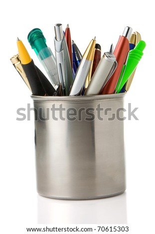 holder basket full of pencils and pens isolated on white background - stock photo
