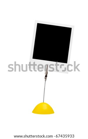 holder with instant photo isolated on a white background.