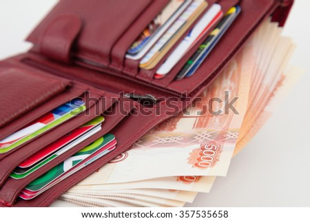 holder with money and bank cards on a white background