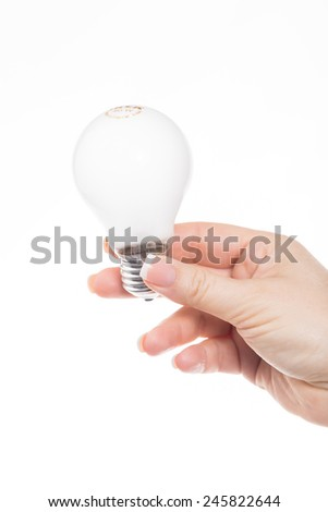 holding a bulb - stock photo