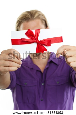 holding a coupon in front of his face - stock photo