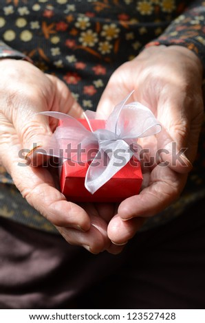 holding a gift pack - stock photo